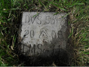 A survey monument. Image source: landsurveyorsunited.com
